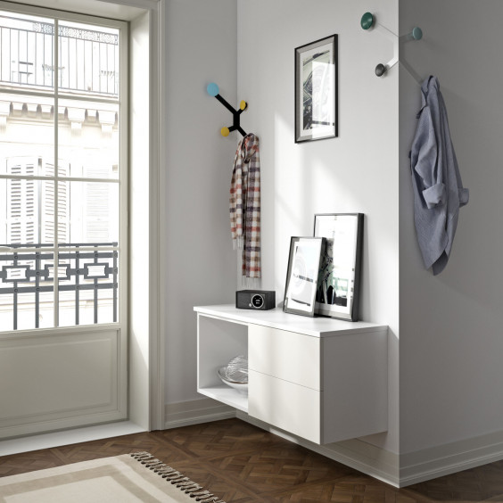 A small entryway furnished with wall mounted storage cabinets and two corner coat hooks