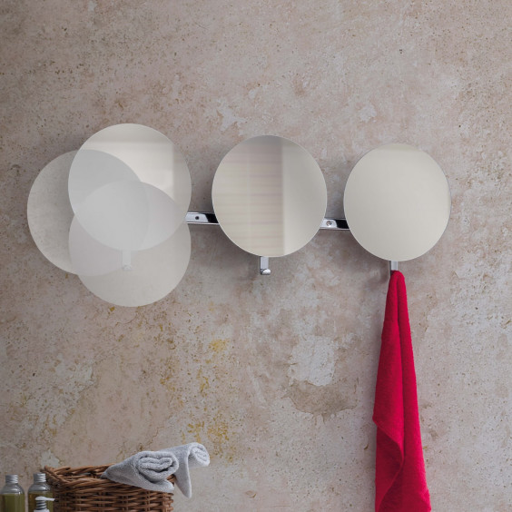 Lady round wall coat rack with mirror pictured in a bathroom.