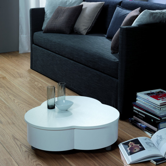 Petalo is a low coffee table for the sitting room with rotating top and compartment